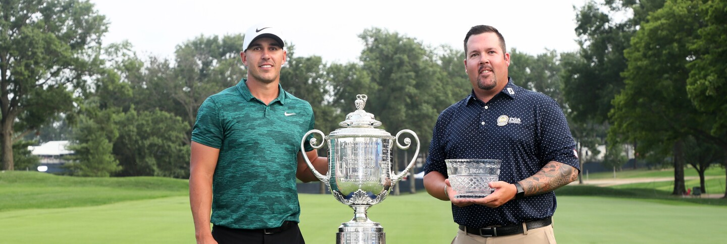 Ben Kern stands with Brooks Koepka after finishing as the Low Club Professional at the 2018 PGA Championship