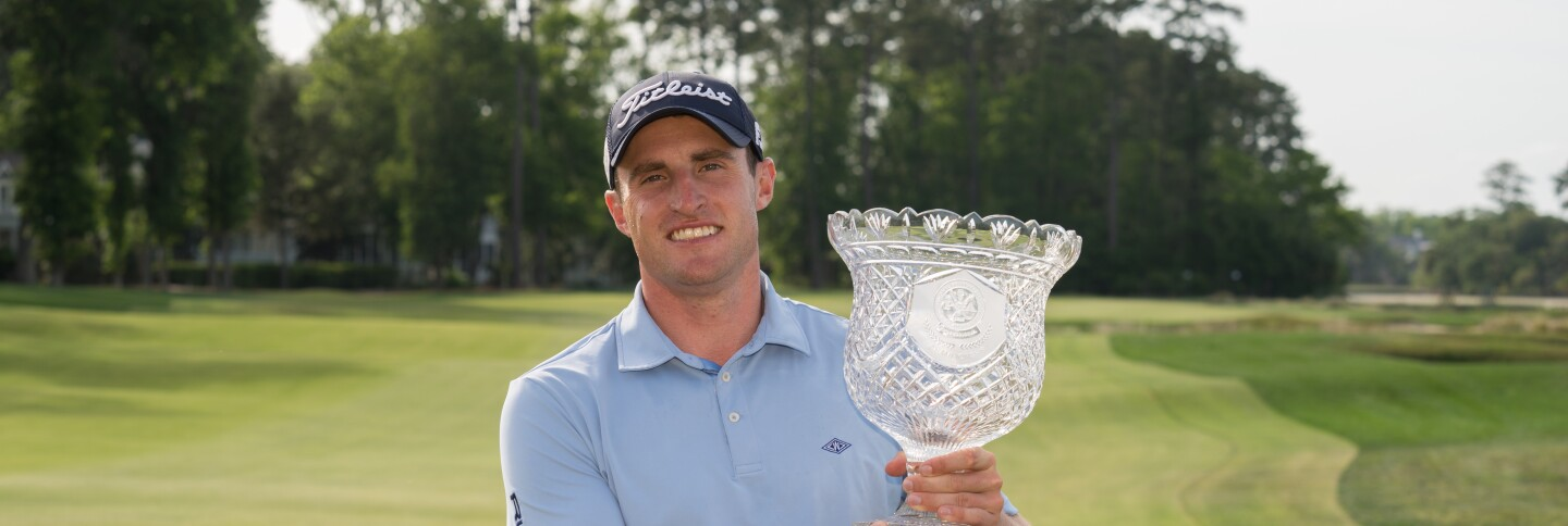 Alex Beach holds the trophy after winning the 2019 PGA Professional Championship