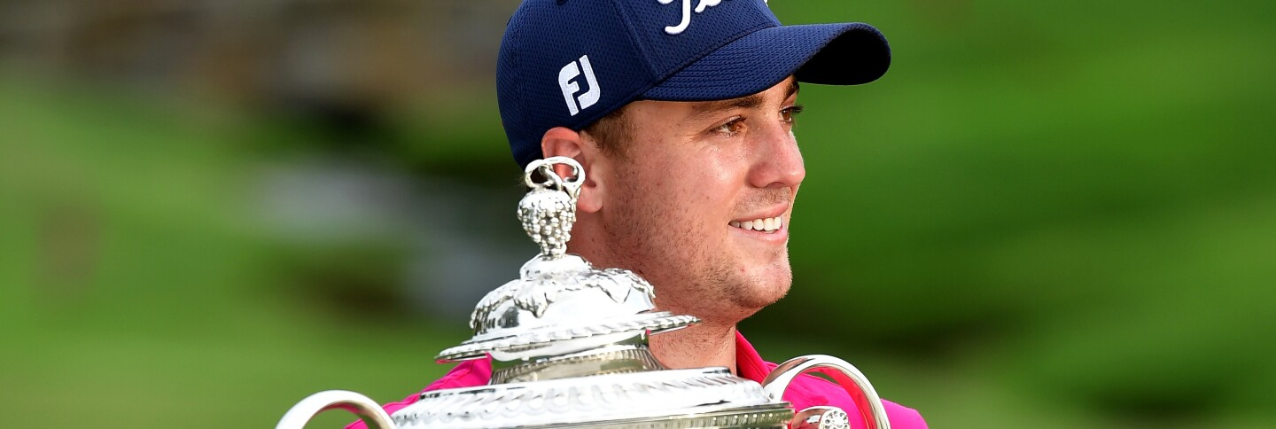 Justin Thomas poses with the Wanamaker Trophy